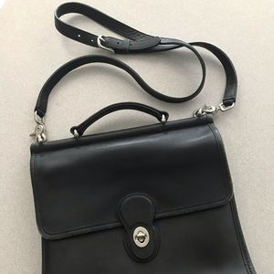 Coach black leather 'station' handbag
